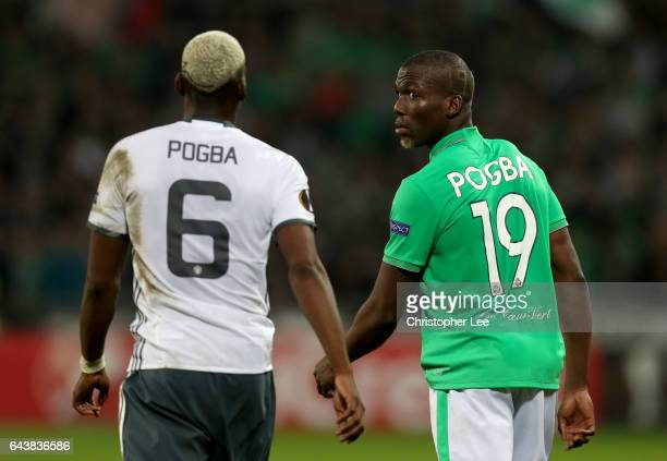 Florentin Pogba of SaintEtienne walks on the pitch next to his brother Paul Pogba of Manchester United during the UEFA Europa League Round of 32...
