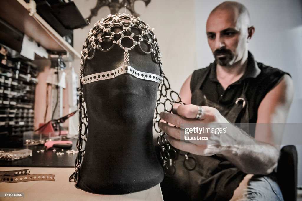 Florentine craftsman artist of French-Algerian origin Idriss Guelai creates in his atelier a copy of Madonna's jewels mask on July 16, 2013 in Florence, Italy. The 45 year old artist artist-craftsman started as a decorator and costume designer for discos and today creates precious sculptures using a variety of materials. A photograph of Madonna wearing a mask jewel created by Idriss Guelai appeared in many newspapers around the world and across social networks. The singer pre-empted a fashion shoot undertaken for Harper's Bazaar and due out in November, by instagramming a photograph of herself while wearing the Idriss Guelai's jewel mask with the phrase: 'The Revolution of Love is on'.