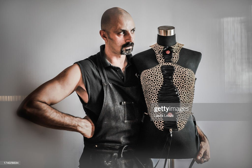 Florentine craftsman artist of French-Algerian origin Idriss Guelai poses in his atelier with one of his jewel sculpture on July 16, 2013 in Florence, Italy. The 45 year old artist artist-craftsman started as a decorator and costume designer for discos and today creates precious sculptures using a variety of materials. A photograph of Madonna wearing a mask jewel created by Idriss Guelai appeared in many newspapers around the world and across social networks. The singer pre-empted a fashion shoot undertaken for Harper's Bazaar and due out in November, by instagramming a photograph of herself while wearing the Idriss Guelai's jewel mask with the phrase: 'The Revolution of Love is on'.