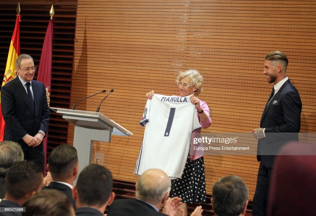 Florentino Perez, Manuela Carmena and Sergio Ramos celebrate during the Real Madrid celebration the day after winning the 12th UEFA Champions League Final at Madrid town hall on June 4, 2017 in Madrid, Spain.