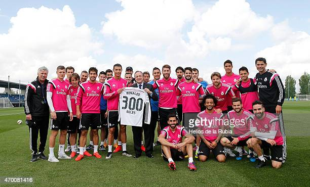 Florentino Perez President of Real Madrid hands a shirt to Cristiano Ronaldo to mark him reaching 300 goals after a training session at Valdebebas...