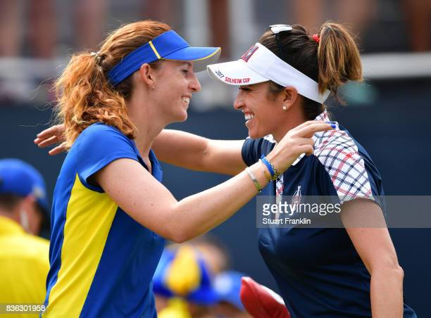 Florentyna Parker of Team Europe greets Gerina Piller of Team USA during the final day singles matches of The Solheim Cup at Des Moines Golf and...