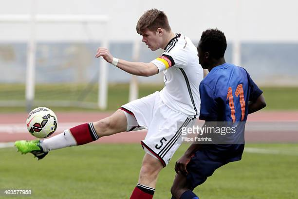 Florian Baak of Germany challenges Bobby Adekanye of Netherlands during the U16 UEFA development tournament between Germany and Netherlands on...