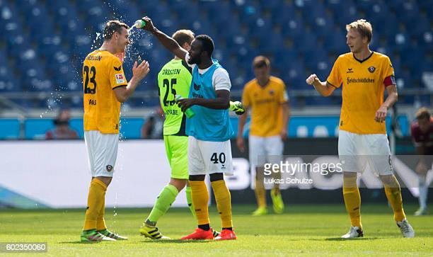 Florian Ballas of Dresden Erich Berko of Dresden and Marco Hartmann of Dresden react after winning the Second Bundesliga match between Hannover 96...