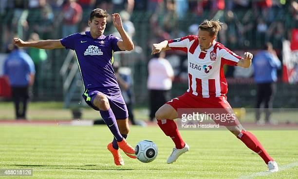 Florian Bichler of Erfurt challenges Julian Riedel of Aue during the Third League match between FC Rot Weiss Erfurt and FC Erzgebirge Aue at...