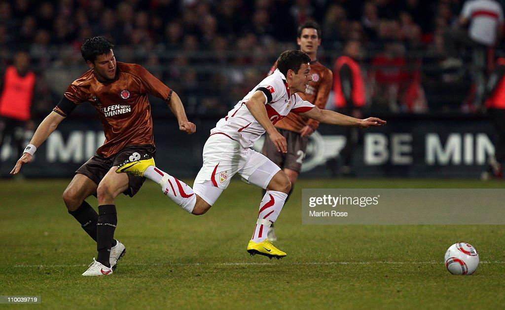 Florian Bruns of St Pauli and Stefano Celozzi of Stuttgart battle for the ball during the Bundesliga match between FC St Pauli and VfB Stuttgart at...