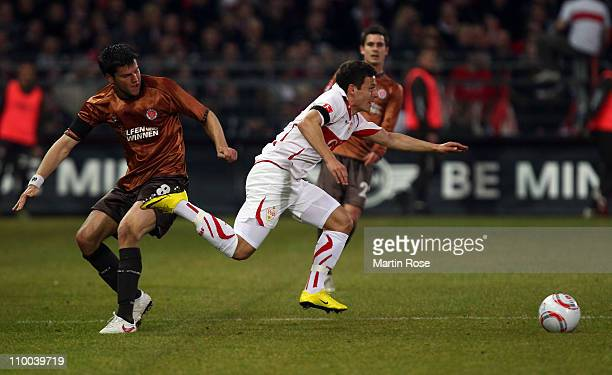 Florian Bruns of St Pauli and Stefano Celozzi of Stuttgart battle for the ball during the Bundesliga match between FC St Pauli and VfB Stuttgart at...