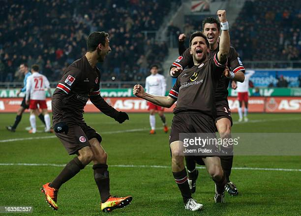 Florian Bruns of St Pauli celebrates with his team mates after scoring his team's third goal during the Second Bundesliga match between FC St Pauli...