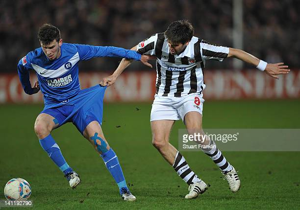 Florian Bruns of St Pauli is challenged by Pascal Gross of Karlsruher during the second Bundesliga match between St Pauli and Karlsruher SC at the...