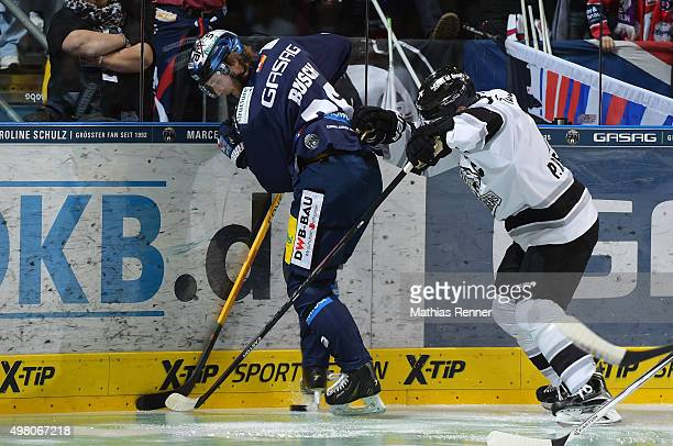Florian Busch of the Eisbaeren Berlin and Patrick Reimer of the Thomas Sabo Ice Tigers Nuernberg during the game between the Eisbaeren Berlin and the...