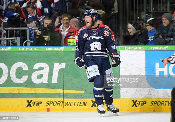 Florian Busch of the Eisbaeren Berlin celebrates after scoring the 54 during the game between Eisbaeren Berlin and Augsburger Panther on february 13...