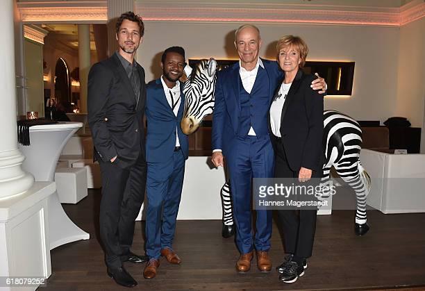 Florian David Fitz Eric Kabongo Heiner Lauterbach and Ulrike Kriener during the 'Willkommen bei den Hartmanns' after party at Palais Lenbach on...
