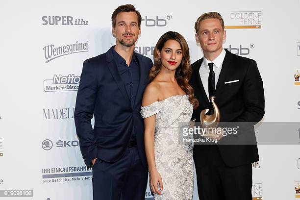 Florian David Fitz Gizem Emre and Matthias Schweighoefer attend the Goldene Henne on October 28 2016 in Leipzig Germany