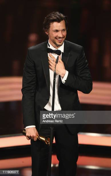 Florian David Fitz receives the Lola for Best Actor during the German Film Award 2011 at Friedrichstadtpalast on April 8 2011 in Berlin Germany