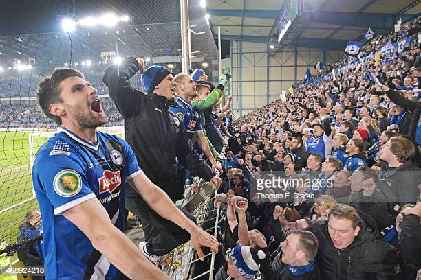 Florian Dick and his Bielefeld team mates celebrate after winning the DFB Cup match between Arminia Bielefeld and Borussia Moenchengladbach at...