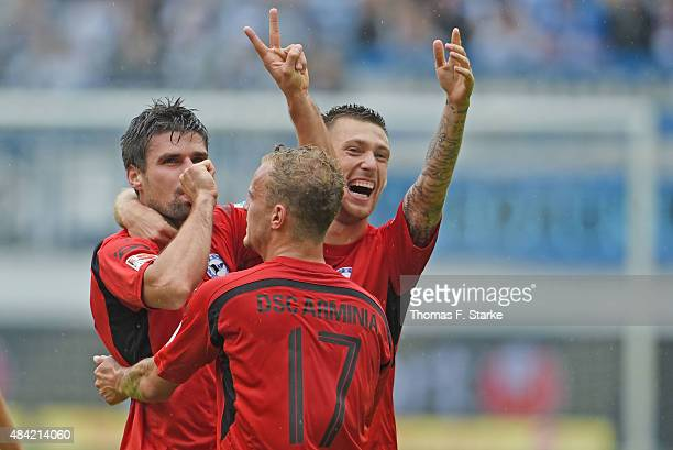 Florian Dick Christoph Hemlein and Manuel Junglas of Bielefeld celebrate their teams second goal during the Second Bundesliga match between MSV...