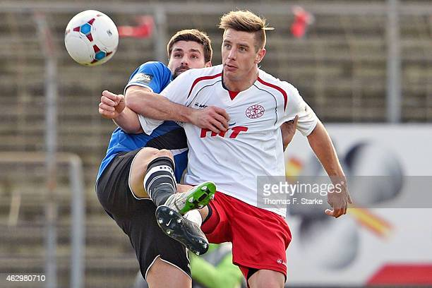 Florian Dick of Bielefeld and Johannes Rahn of Koeln fight for the ball during the Third League match between between Fortuna Koeln and Arminia...