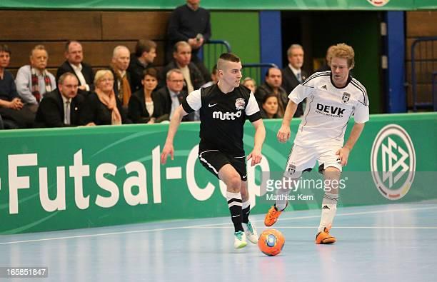 Florian Dondorf of Muenster battles for the ball with Carlos Rafael Ferreira Monteiro of Hamburg during the DFB Futsal Cup final match between...