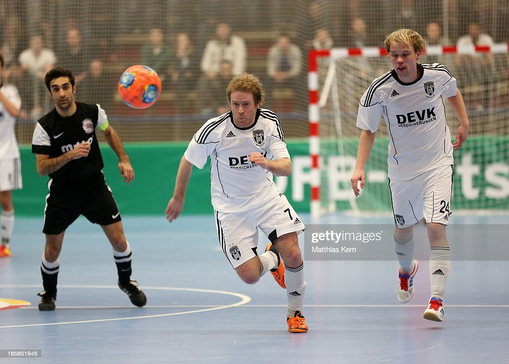 Florian Dondorf (C) of Muenster runs with the ball during the DFB Futsal Cup final match between Hamburg Panthers and UFC Muenster at Sporthalle Wandsbek on April 6, 2013 in Hamburg, Germany.