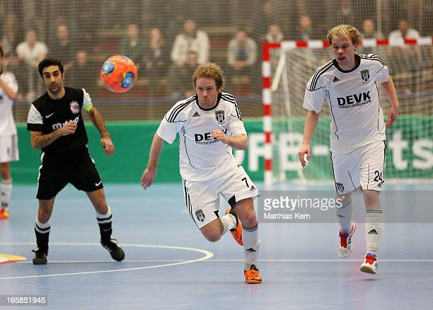 Florian Dondorf of Muenster runs with the ball during the DFB Futsal Cup final match between Hamburg Panthers and UFC Muenster at Sporthalle Wandsbek...