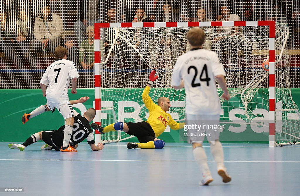 Florian Dondorf (L) of Muenster scores the first goal during the DFB Futsal Cup final match between Hamburg Panthers and UFC Muenster at Sporthalle Wandsbek on April 6, 2013 in Hamburg, Germany.