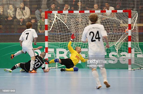 Florian Dondorf of Muenster scores the first goal during the DFB Futsal Cup final match between Hamburg Panthers and UFC Muenster at Sporthalle...