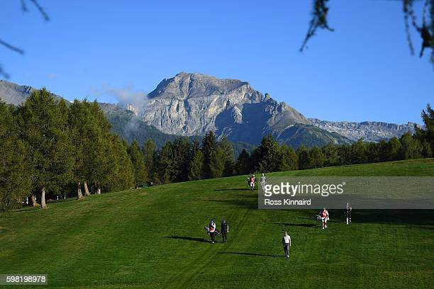 Florian Fitsch of Germany Jeff Winther of Denmark and Chiragh Kumar of India walk down the 12th fairway during the first round of the Omega European...