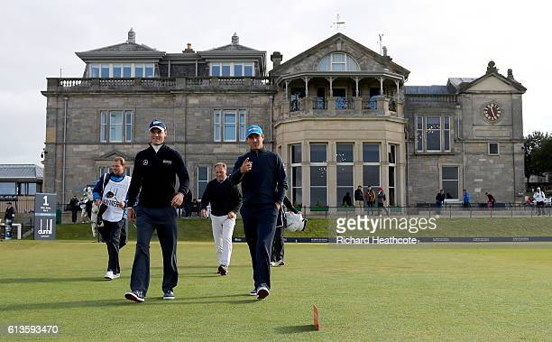 Florian Fritsch and Martin Kaymer of Germany walk down the first hole during the final round of the Alfred Dunhill Links Championship at The Old...