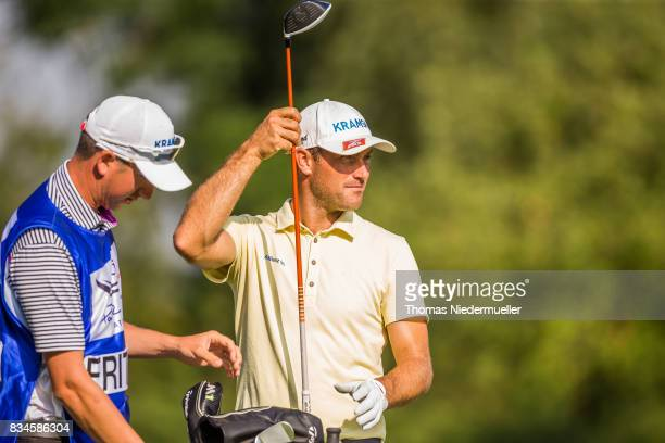 Florian Fritsch of Germany and his caddie are seen during day two of the Saltire Energy Paul Lawrie Matchplay at Golf Resort Bad Griesbach on August...
