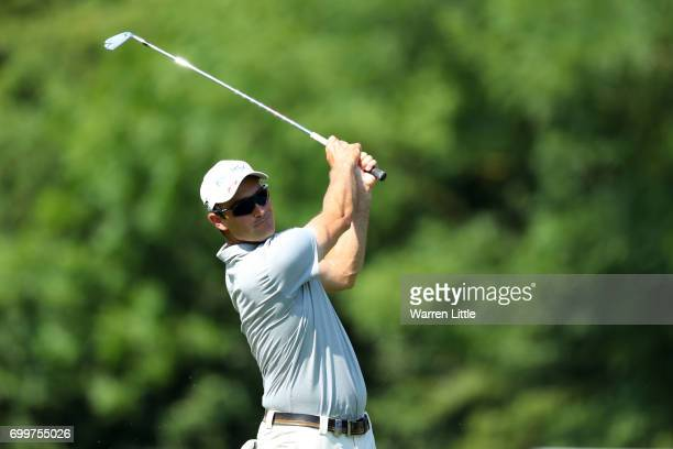 Florian Fritsch of Germany hits his second shot on the 10th hole during day one of the BMW International Open at Golfclub Munchen Eichenried on June...