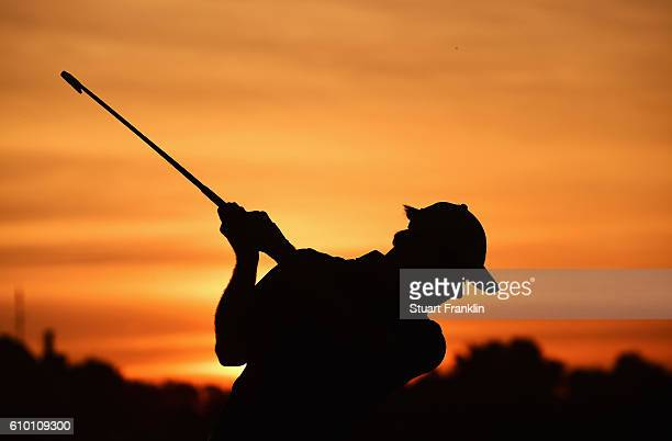 Florian Fritsch of Germany plays a shot on the range after the continuation of the delayed second round of The Porsche European Open at Golf Resort...