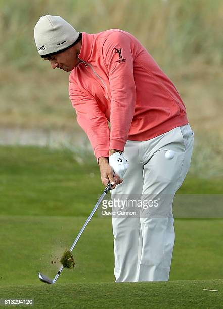 Florian Fritsch of Germany plays his second shot to the 18th green during the third round of the Alfred Dunhill Links Championship at Carnoustie Golf...
