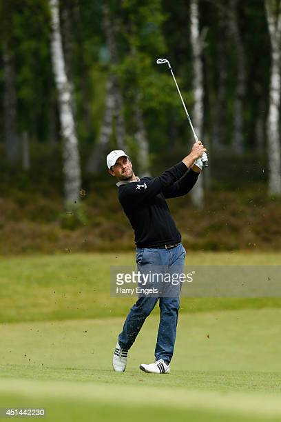Florian Fritsch of Germany plays off the fairway at the eighth on day four of the 2014 Scottish Hydro Challenge hosted by Macdonald Hotels Resorts at...
