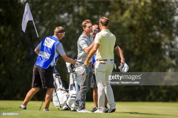 Florian Fritsch of Germany shake hands with Lucas Bjerregaard of Denmark during the Saltire Energy Paul Lawrie Matchplay at Golf Resort Bad Griesbach...