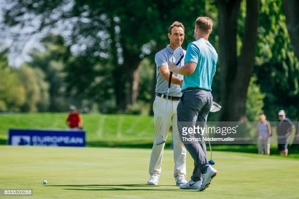 Florian Fritsch of Germany shake hands with Oliver Fisher of England at day one of the Saltire Energy Paul Lawrie Matchplay at Golf Resort Bad...