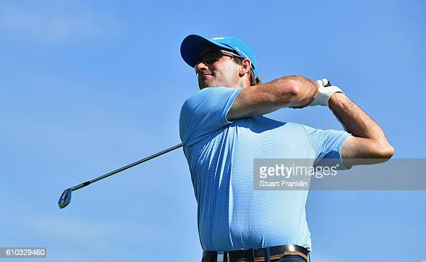 Florian Fritsch of Germany watches the flight of his ball during the final round of the Porsche European Open at Golf Resort Bad Griesbach on...