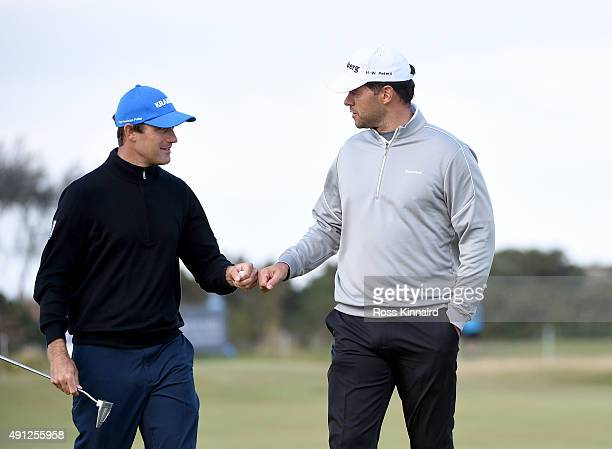 Florian Fritsch of Germany with his playing partner former German football Michael Ballack on the third green during final round of the 2015 Alfred...