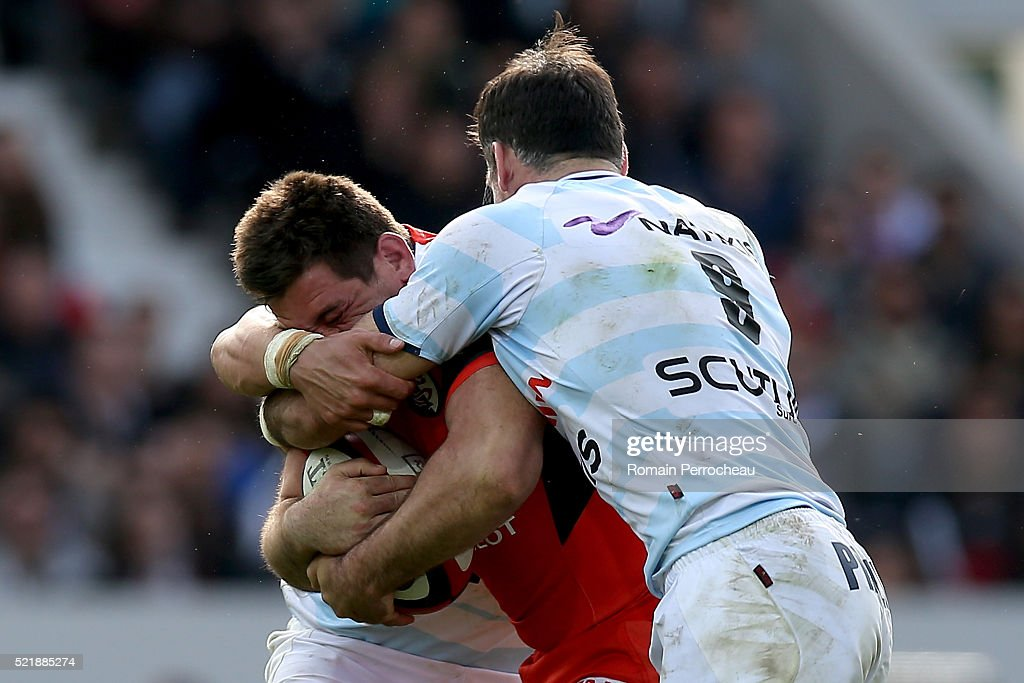 <a gi-track='captionPersonalityLinkClicked' href=/galleries/search?phrase=Florian+Fritz&family=editorial&specificpeople=540919 ng-click='$event.stopPropagation()'>Florian Fritz</a> for Toulouse is tackled by Mike Phillips for Racing 92 during the French Top 14 rugby union match between Toulouse v Racing 92 at Stadium on April 17, 2016 in Toulouse, France.