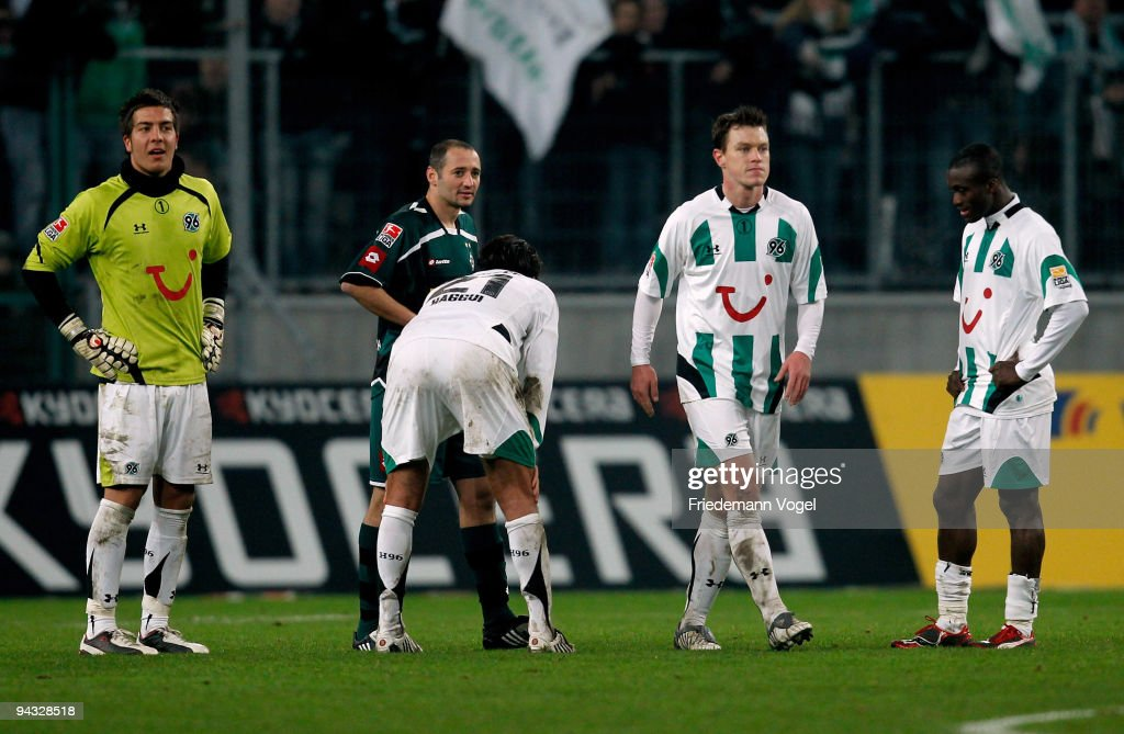 Florian Fromlowitz, Karim Haggui, Hanno Balitsch and Constant Djakpa of Hannover look dejected during the Bundesliga match between Borussia Moenchengladbach and Hannover 96 at Borussia Park Stadium on December 12, 2009 in Monchengladbach, Germany.