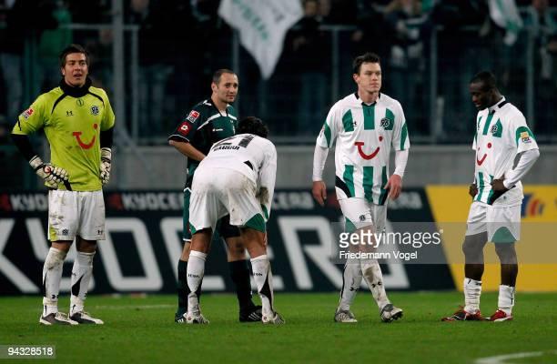 Florian Fromlowitz Karim Haggui Hanno Balitsch and Constant Djakpa of Hannover look dejected during the Bundesliga match between Borussia...