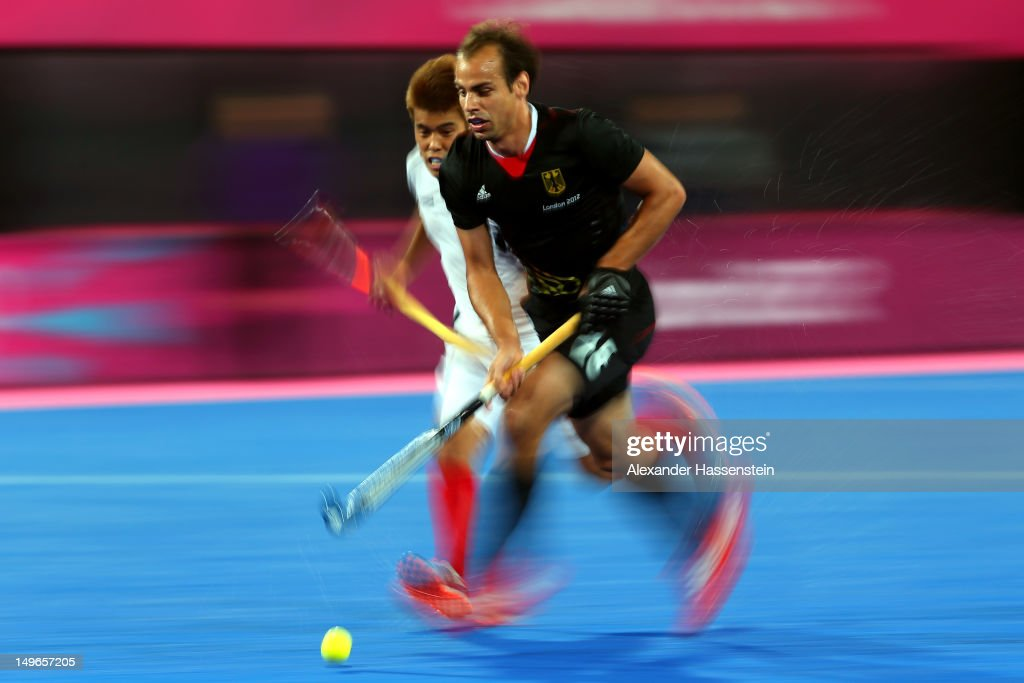 Florian Fuchs (R) of Germany battles for the ball with Dae Keun Oh of Korea during the Men's Hockey match between Korea and Germany on Day 5 of the London 2012 Olympic Games at the Riverbank Arena on August 1, 2012 in London, England.