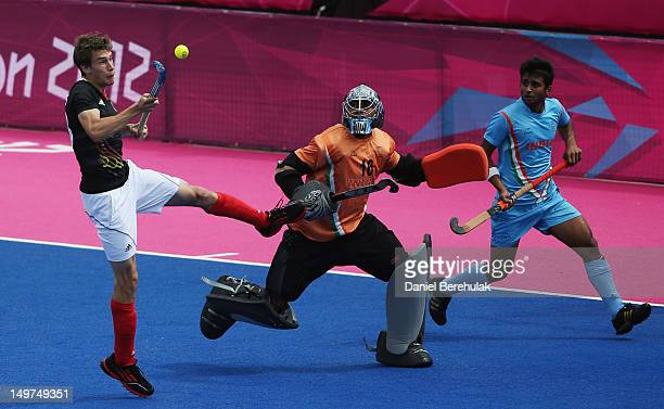 Florian Fuchs of Germany shoots to score past goalkeeper Sreejesh Parattu Raveendran of India during the Men's Hockey match between Germany and India...