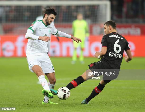 Florian Grillitsch of Bremen and Aleksandar Dragovic of Leverkusen battle for the ball during the Bundesliga soccer match between Bayer Leverkusen...