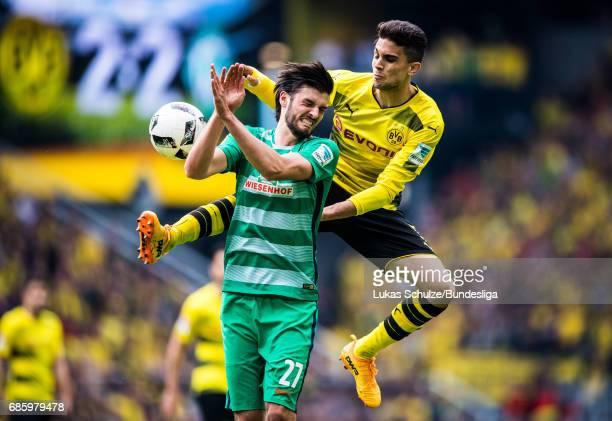 Florian Grillitsch of Bremen and Marc Bartra of Dortmund fight for the ball during the Bundesliga match between Borussia Dortmund and Werder Bremen...