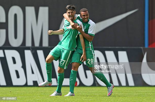 Florian Grillitsch of Bremen jubilates with team mate Leon Guwara after scoring the second goal during the third league match between FC Hansa...