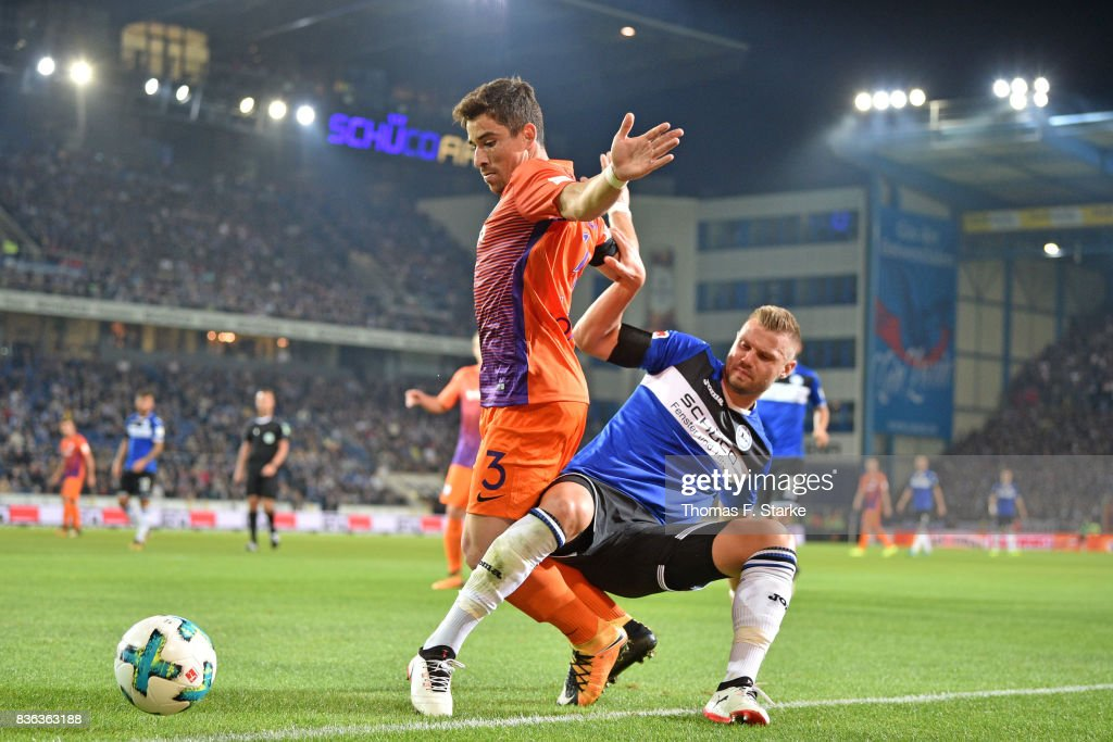 Florian Hartherz (R) of Bielefeld tackles Danilo Soares of Bochum during the Second Bundesliga match between DSC Arminia Bielefeld and VfL Bochum 1848 at Schueco Arena on August 21, 2017 in Bielefeld, Germany.