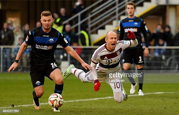 Florian Hartherz of SC Paderborn tackles Arjen Robben of Bayern Muenchen during the Bundesliga match between SC Paderborn and FC Bayern Muenchen at...