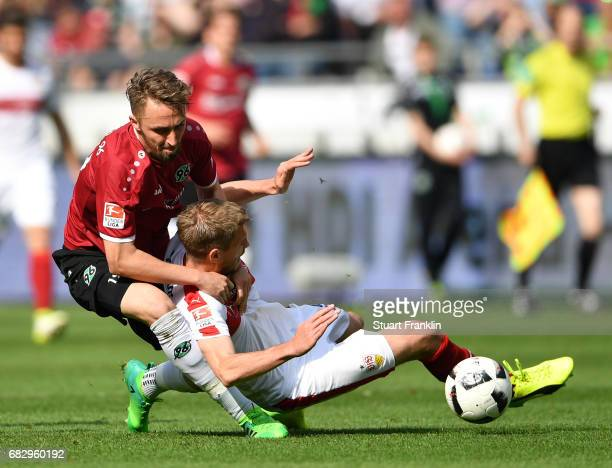 Florian Hbner of Hannover is challenged by Simon Terodde of Stuttgart during the Second Bundesliga match between Hannover 96 and VfB Stuttgart at...