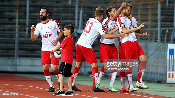 Florian Hoernig of Fortuna Koeln celebrates the second goal with his team mates during the 3 Liga match between Fortuna Koeln and Energie Cottbus at...