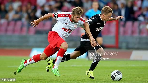Florian Hoernig of Fortuna Koeln challenges Robin Szarka of Cottbus during the 3 Liga match between Fortuna Koeln and Energie Cottbus at Suuedstadion...